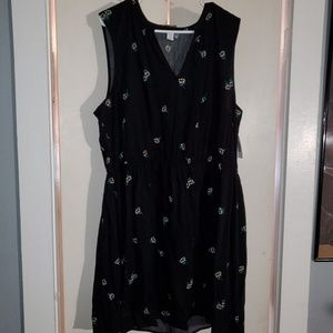 Sleeveless black flowered dress